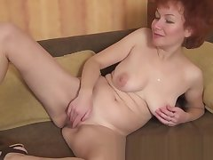 Julia fingers the brush mature cougar vagina