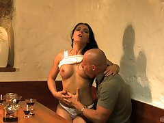 Brunette babe Honey Demon gives a blowjob and gets fucked on the table