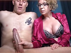 Wild mature girl wide blondie hair and glasses is groping manhood in front of the camera