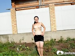 Provocative outdoor measure with a very busty raunchy mature