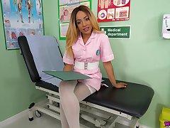 Wondrous ebony nurse Kayla Louise stands on knees to wank a fake cock a bit